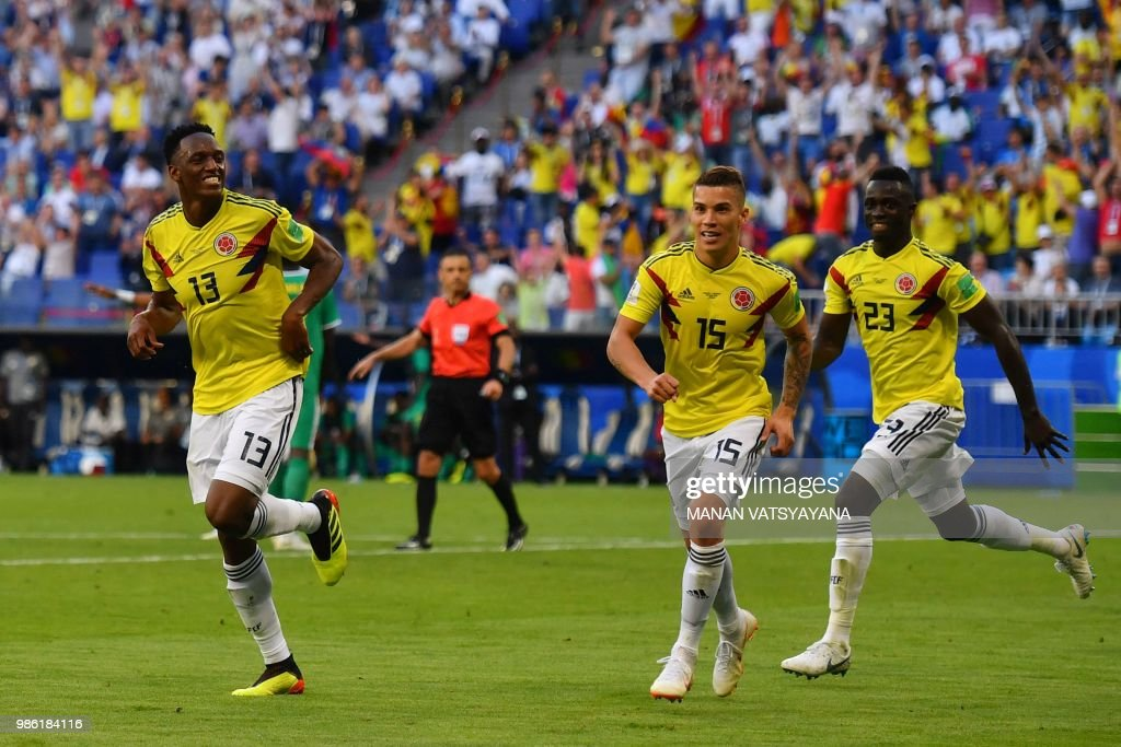 1bda546a7 Colombia s defender Yerry Mina celebrates with teammates after ...