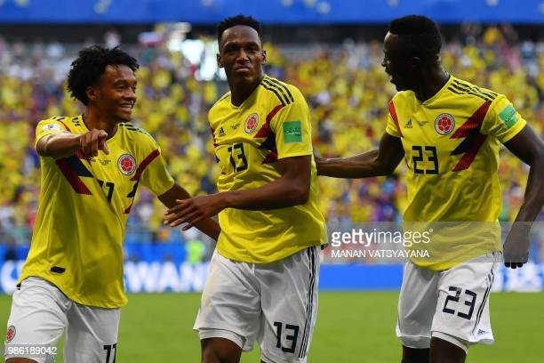 TOPSHOT Colombia's defender Yerry Mina celebrates with teammates after scoring a goal during the Russia 2018 World Cup Group H football match between...