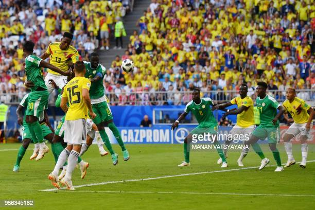 TOPSHOT Colombia's defender Yerry Mina heads and scores a goal during the Russia 2018 World Cup Group H football match between Senegal and Colombia...
