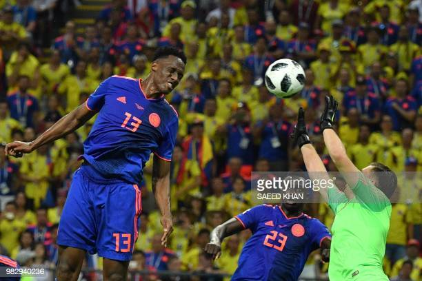 TOPSHOT Colombia's defender Yerry Mina heads to score the opener during the Russia 2018 World Cup Group H football match between Poland and Colombia...
