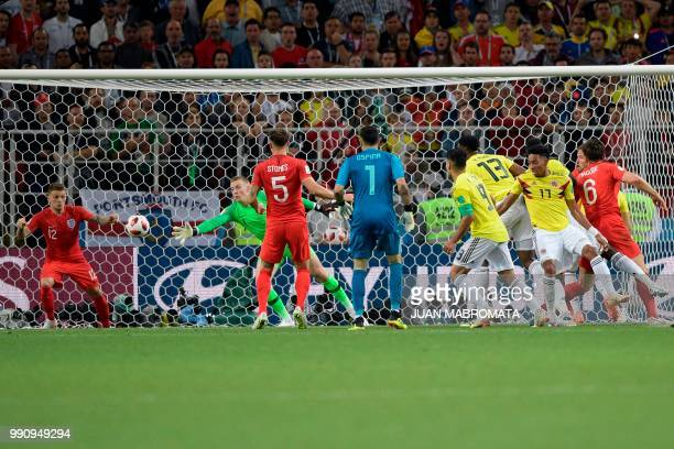 Colombia's defender Yerry Mina scores a goal during the Russia 2018 World Cup round of 16 football match between Colombia and England at the Spartak...
