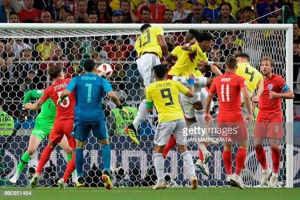 TOPSHOT Colombia's defender Yerry Mina scores a goal during the Russia 2018 World Cup round of 16 football match between Colombia and England at the...