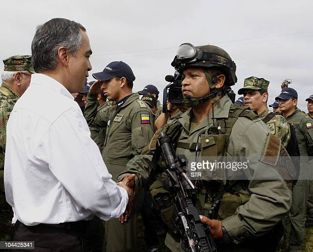 Colombia's Defense Minister Rodrigo Rivera shakes hands with a police officer from an elite unit as he visits the Macarena region, Meta department,...