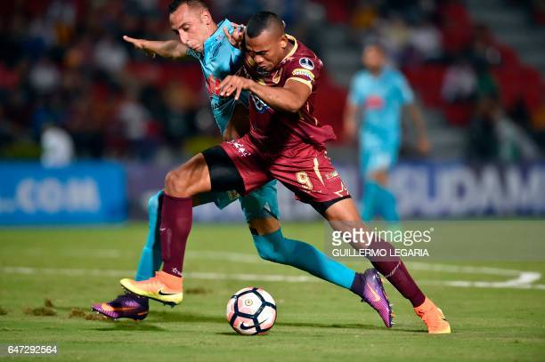 Colombia's Deportes Tolima player Angelo Rodriguez vies for the ball with Bolivia's Bolivar player Mauricio Prieto during their Copa Sudamericana...