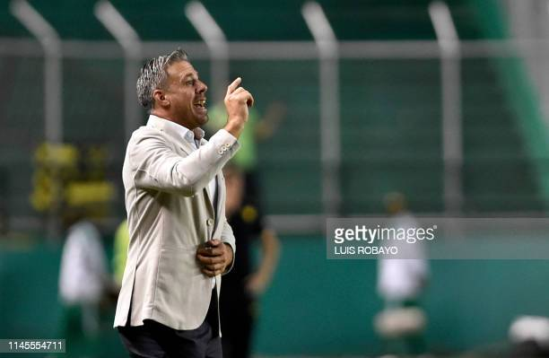 Colombia's Deportivo Cali coach Argentinian Lucas Pusineri gives instructions to his players during a Copa Sudamericana football match against...
