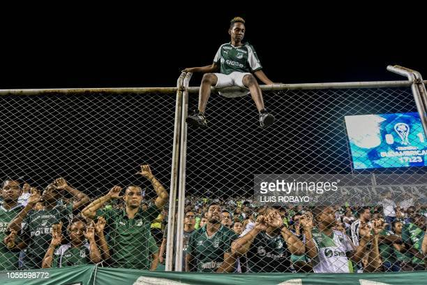 TOPSHOT Colombia's Deportivo Cali fans react after a goal scored by Colombia's Independiente Santa Fe midfielder Uruguayan Diego Guastavino during a...