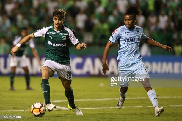 Colombia's Deportivo Cali Matias Cabrera vies for the ball with Bolivia's Bolivar Leonel Morales during their 2018 Copa Suramericana football match...