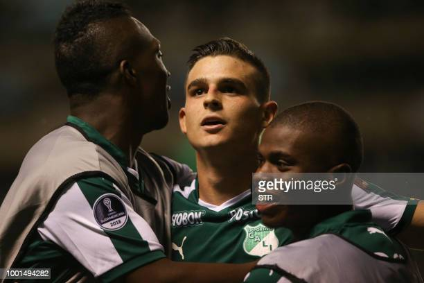 Colombia's Deportivo Cali Nicolas Benedetti celebrates his goal with teammates against Bolivia's Bolivar during their 2018 Copa Sudamericana football...
