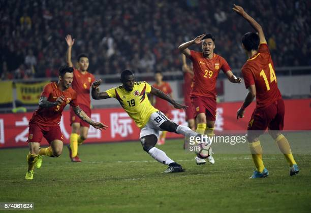 Colombia's Duvan Zapata fights for the ball with China's Zhang Linpeng during their international friendly football match in Chongqing southwest...