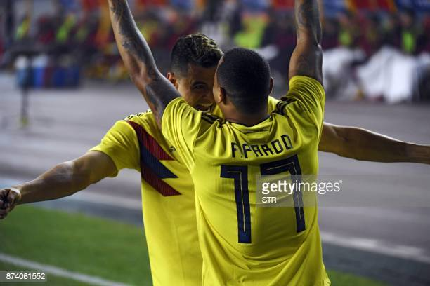 Colombia's Edgar Parado celebrates with teammate Giovanni Moreno after scoring a goal during their international friendly football match against...