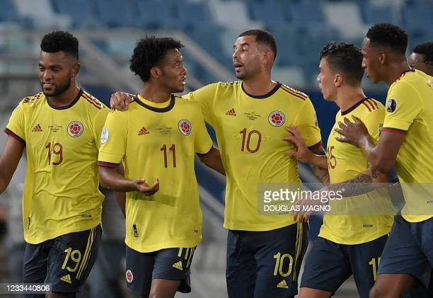 Colombia's Edwin Cardona celebrates with teammates after scoring against Ecuador during the Conmebol Copa America 2021 football tournament group...