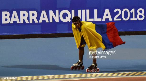 Colombia's Edwin Estrada celebrates after winning the men's 500m speed skating sprint final event during the 2018 Central American and Caribbean...