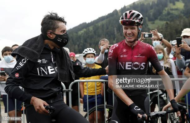 Colombia's Egan Bernal and Britain's Chris Froome of Team Ineos speak together as they celebrate after competing in the 3rd stage of the La Route...