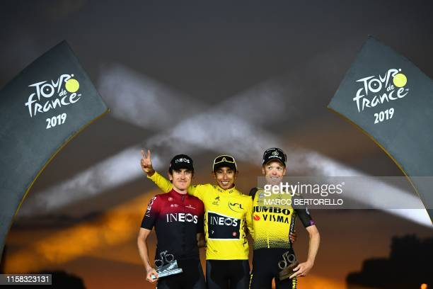 TOPSHOT Colombia's Egan Bernal celebrates his overall leader's yellow jersey as he poses with secondplaced Great Britain's Geraint Thomas and...