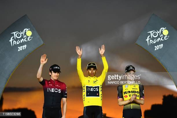 Colombia's Egan Bernal celebrates his overall leader's yellow jersey waves as he poses with secondplaced Great Britain's Geraint Thomas and...
