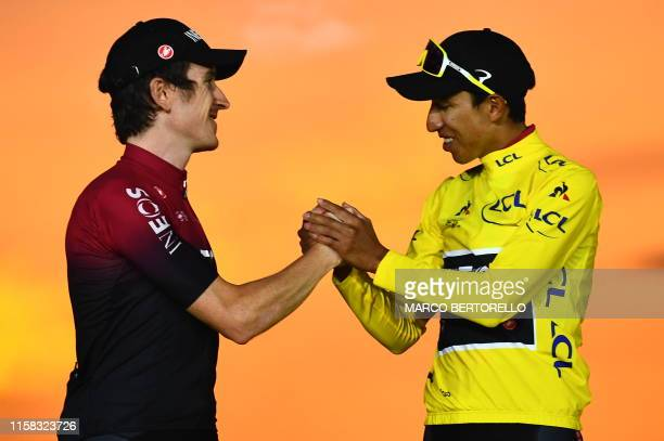 TOPSHOT Colombia's Egan Bernal is congratulated by secondplaced Great Britain's Geraint Thomas as he celebrates his overall leader's yellow jersey on...