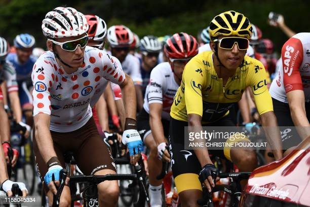 Colombia's Egan Bernal , wearing the overall leader's yellow jersey and France's Romain Bardet, wearing the best climber's polka dot jersey ride in...