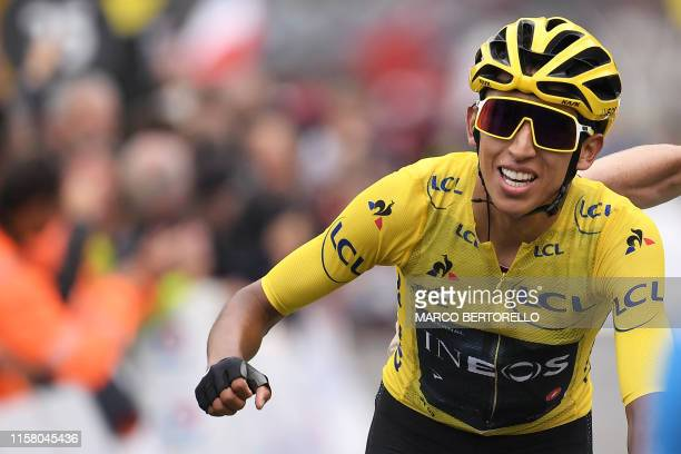 Colombia's Egan Bernal, wearing the overall leader's yellow jersey celebrates as he crosses the finish line of the twentieth stage of the 106th...