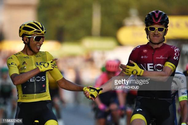 Colombia's Egan Bernal , wearing the overall leader's yellow jersey is congratulated by teammate Great Britain's Geraint Thomas as he celebrates his...