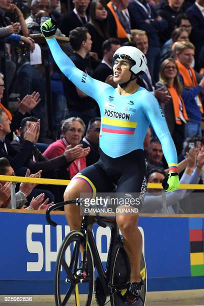 Colombia's Fabian Hernando Puerta Zapata celebrates after winning the men's Keirin final during the UCI Track Cycling World Championships in...