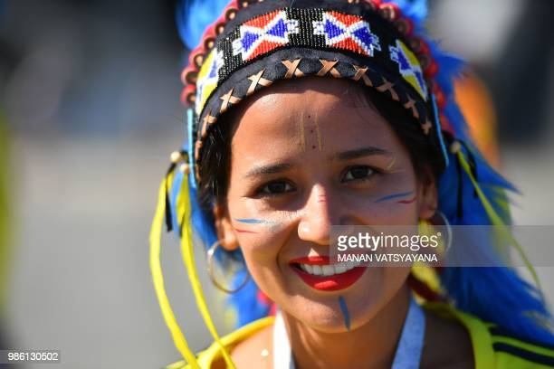 A Colombia's fan cheers as she arrives to attend the Russia 2018 World Cup Group H football match between Senegal and Colombia at the Samara Arena in...