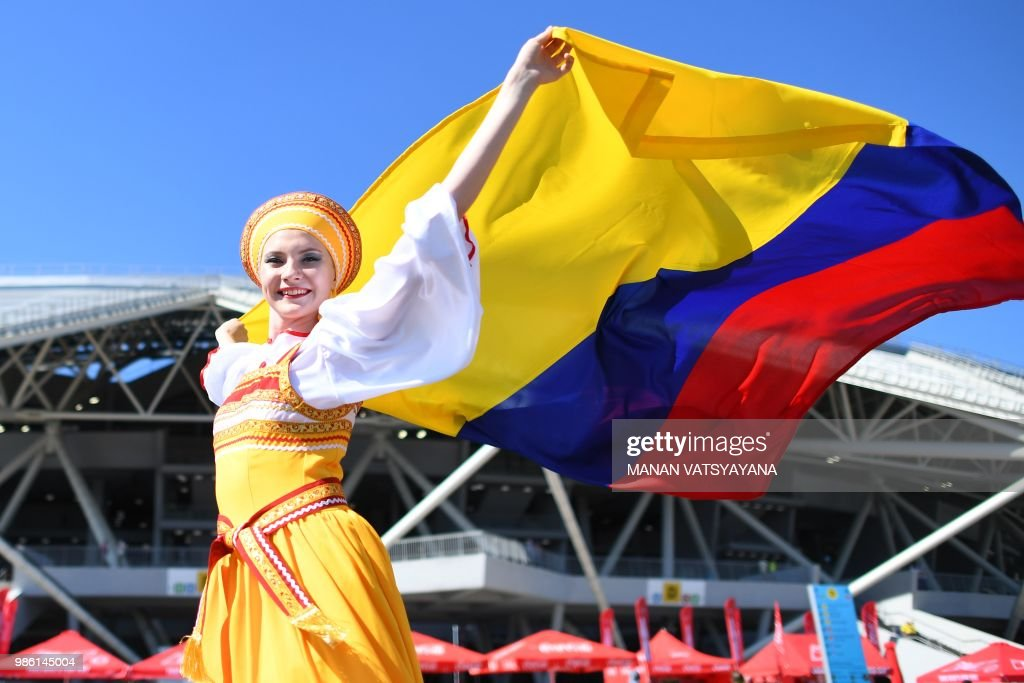 Colombia's fan cheers as she arrives to attend the Russia 2018 World Cup Group H football match between Senegal and Colombia at the Samara Arena in Samara on June 28, 2018. (Photo by Manan VATSYAYANA / AFP) / RESTRICTED