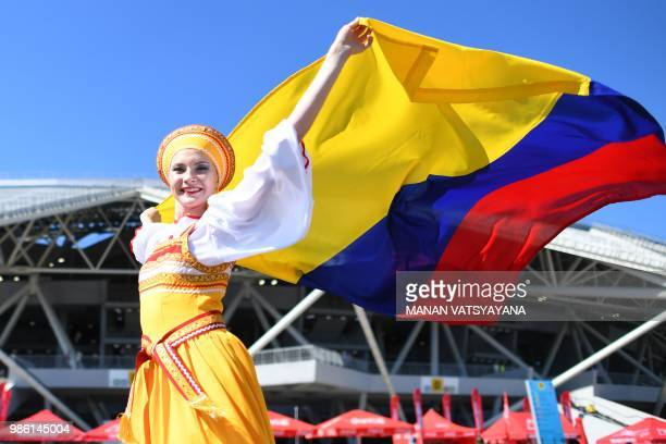 Colombia's fan cheers as she arrives to attend the Russia 2018 World Cup Group H football match between Senegal and Colombia at the Samara Arena in...
