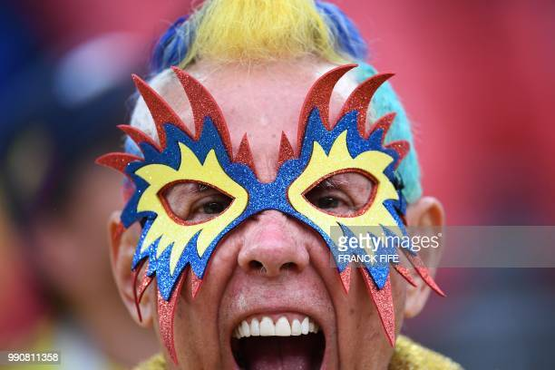 A Colombia's fan cheers prior to the Russia 2018 World Cup round of 16 football match between Colombia and England at the Spartak Stadium in Moscow...