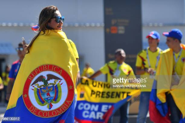 Colombia's fans cheer as they arrive to attend the Russia 2018 World Cup Group H football match between Senegal and Colombia at the Samara Arena in...