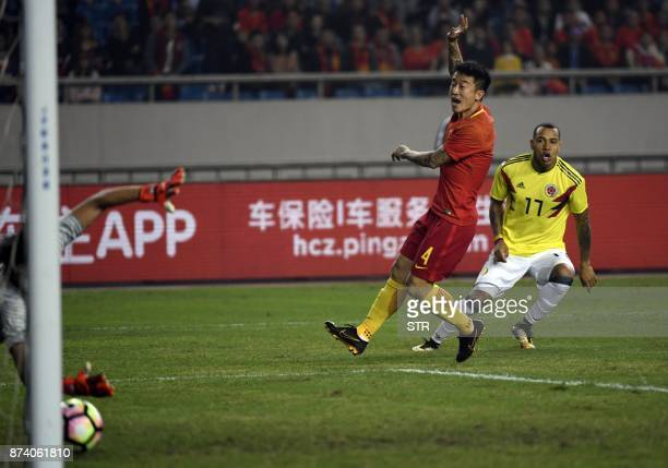 Colombia's Felipe Pardo shoots to score a goal during their international friendly football match against China in Chongqing southwest China on...