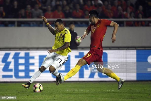 Colombia's Felipe Pardo vies for the ball with China's Zhao Xuri during their international friendly football match in Chongqing southwest China on...