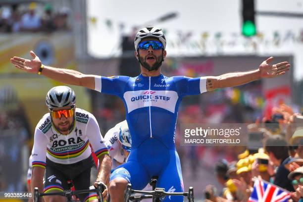 Colombia's Fernando Gaviria celebrates as he crosses the finish line ahead of Slovakia's Peter Sagan to win the first stage of the 105th edition of...