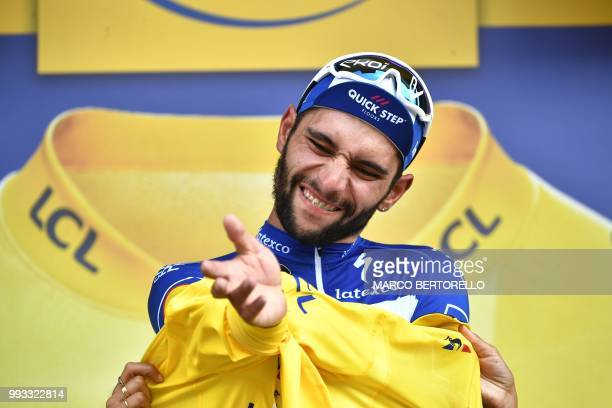 Colombia's Fernando Gaviria puts on the overall leader's yellow jersey on the podium after winning the first stage of the 105th edition of the Tour...