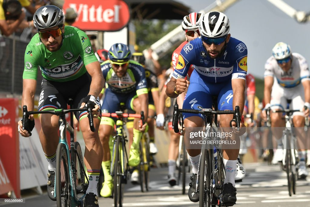 Colombia's Fernando Gaviria (R) reacts after crossing the finish line ahead of Slovakia's Peter Sagan (L) to win the fourth stage of the 105th edition of the Tour de France cycling race between La Baule and Sarzeau, western France, on July 10, 2018.