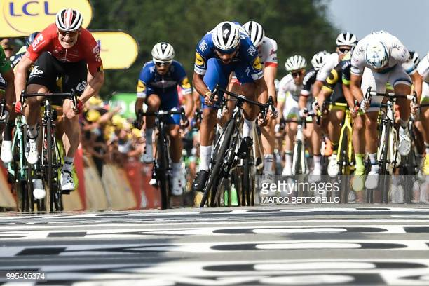 TOPSHOT Colombia's Fernando Gaviria sprints to cross the finish line ahead of Slovakia's Peter Sagan and Germany's Andre Greipel to win the fourth...