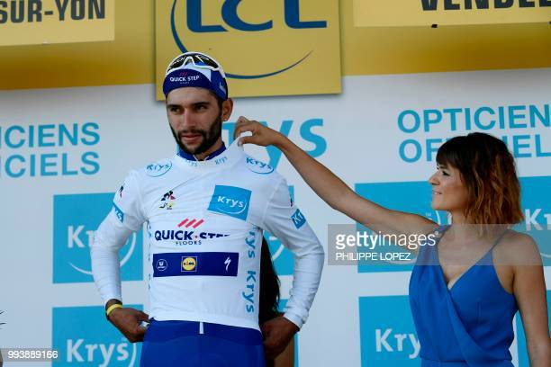Colombia's Fernando Gaviria wearing the best young's white jersey reacts on the podium after the second stage of the 105th edition of the Tour de...