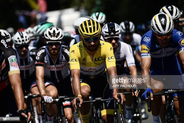 Colombia's Fernando Gaviria wearing the overall leader's yellow jersey rides in the pack during the second stage of the 105th edition of the Tour de...