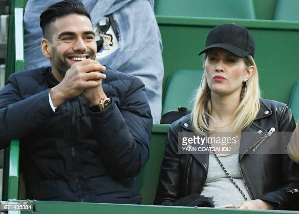 Colombia's football player Radamel Falcao and his wife Lorelei Taron attend the tennis match between Spain's Rafael Nadal and Argentina's Diego...