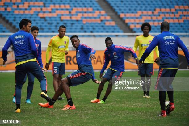 Colombia's football players take part in a training session in Chongqing on November 13 ahead of their international friendly football match against...
