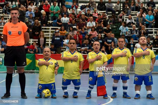 Colombia's football team players sing the national anthem before a Dwarf Copa America football match against Argentina at Ferro Carril Oeste Club in...