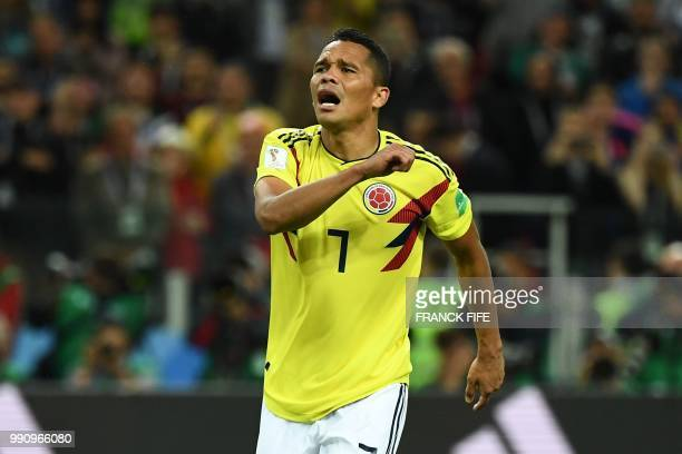 TOPSHOT Colombia's forward Carlos Bacca reacts after missing to score a penalty kick during the penalty shootout of the Russia 2018 World Cup round...