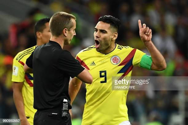 Colombia's forward Falcao gestures as he clashes with US referee Mark Geiger during the Russia 2018 World Cup round of 16 football match between...