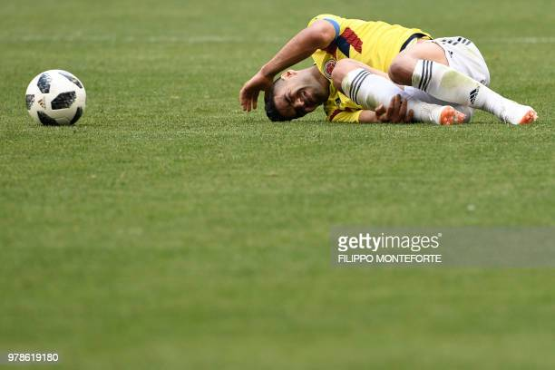 TOPSHOT Colombia's forward Falcao reacts after falling during the Russia 2018 World Cup Group H football match between Colombia and Japan at the...