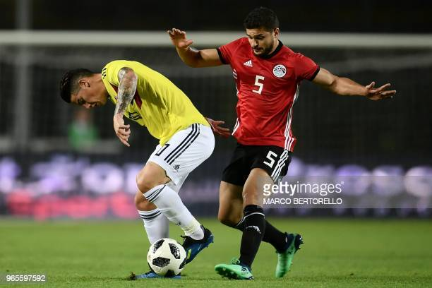 Colombia's forward James Rodriguez vies with Egypt's midifelder Sam Morsy during their international friendly football match Egypt vs Colombia at the...
