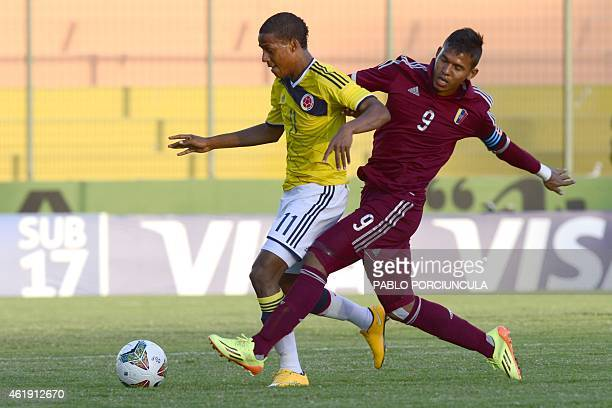 Colombia's forward Jeison Lucumi vies for the ball with Venezuela's forward Andres Ponce during their South American U20 football match at Domingo...