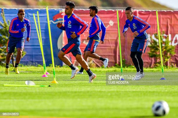 Colombia's forward Luis Muriel forward Falcao midfielders Abel Aguilar and Mateus Uribe take part in a training session in Kazan on June 21 during...