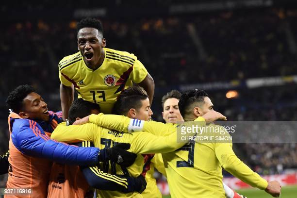 TOPSHOT Colombia's forward Radamel Falcao celebrates with teammates after scoring a goal during the friendly football match between France and...