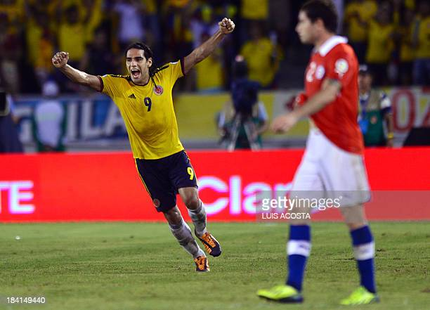Colombia's forward Radamel Falcao Garcia celebrates after scoring a penalty against Chile during their Brazil 2014 FIFA World Cup South American...