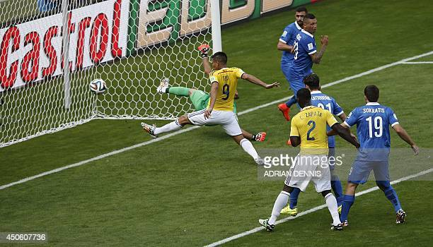 Colombia's forward Teofilo Gutierrez scores during a Group C football match between Colombia and Greece at the Mineirao Arena in Belo Horizonte...
