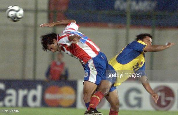 Colombia's Geraldo Bedoya fights for the ball with Paraguay's Roberto Acuna 14 November during their 2002 World Cup qualification match at the Los...